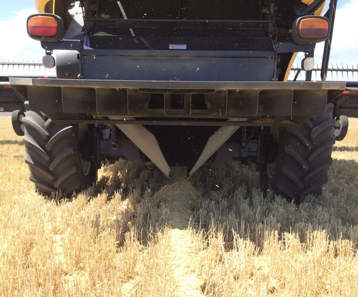 The $200 plastic chute fitted to the harvester funnels the chaff containing the majority of weed seeds present into a narrow band in the middle of the CTF run.